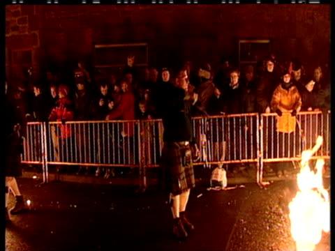 men in kilts walking down street twirling fireballs millennium eve celebrations 31 dec 99 - street party stock videos & royalty-free footage