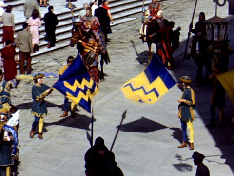 men in medieval armor parading some waving flags some on horseback with lances reenactment of medieval times / various streets medieval buildings... - market reenactment stock videos & royalty-free footage