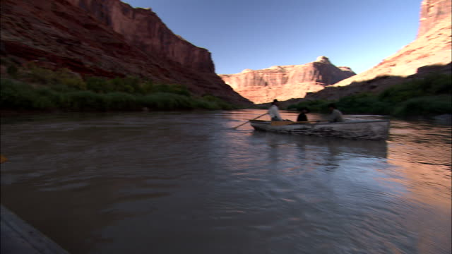 men in old-fashioned western clothing row wooden boats along the colorado river. - reenactment stock videos & royalty-free footage