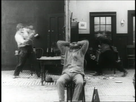 b/w 1916 2 men in pie fight / angry film director in foreground / short - 1916 stock videos & royalty-free footage