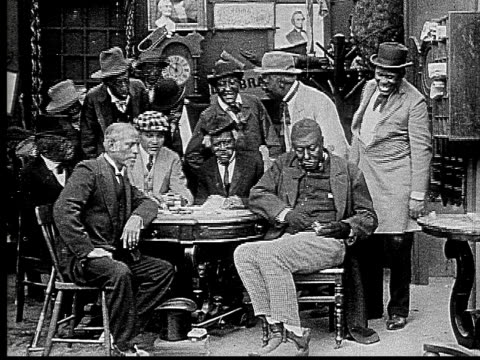 1916 b&w ms men in poker game waiting for man to dig money from pocket  - hosentasche stock-videos und b-roll-filmmaterial