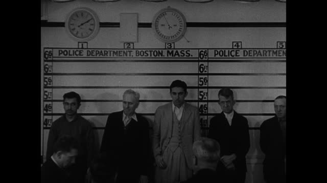 dramatization boston men in police department lineup police inspectors sitting standing together older caucasian male having mug shot taken front... - mug shot stock videos & royalty-free footage