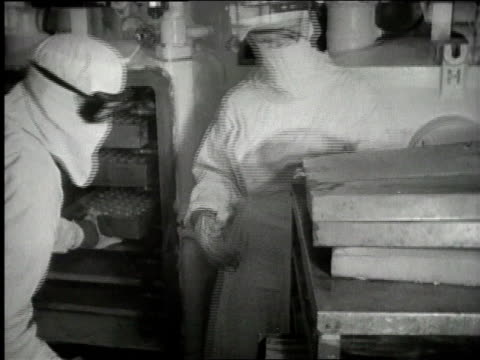 men in protective gear handling trays / women working in packing line with small boxes - penicillin stock videos and b-roll footage