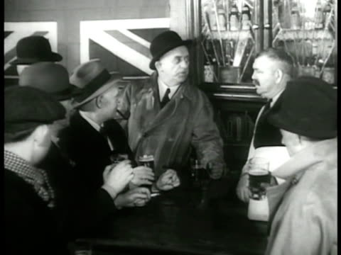 stockvideo's en b-roll-footage met dramatization men in pub drinking beer northern ireland male sot saying 'republic is it let them try to get us into their republic if they want a... - 1937