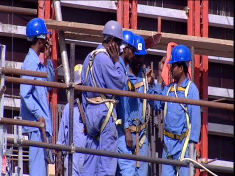 Men In Safety Harnesses Work On Scaffold Dubai Stock Footage Video