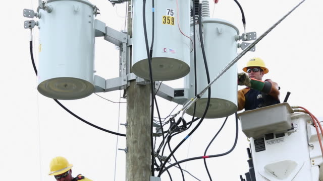 ms la td men in saftey gear attaching power line to transformer box / oyster, virginia, usa - transformer stock videos & royalty-free footage