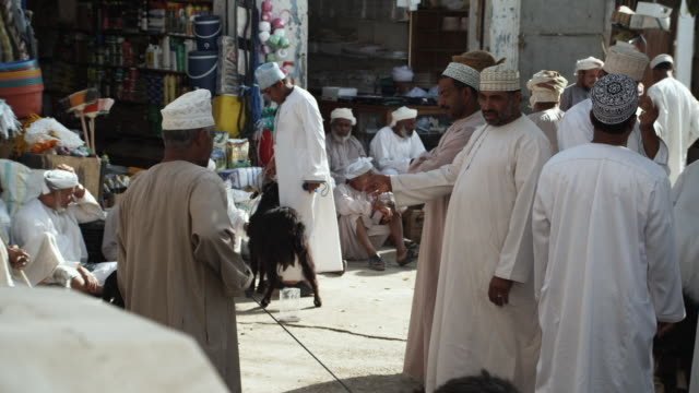 MS Men in souk selling and buying livestock, Bahla, Oman