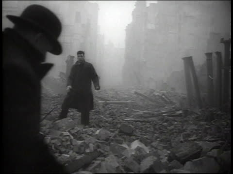 men in suits climbing through rubble on streets of london / united kingdom - the blitz stock videos and b-roll footage