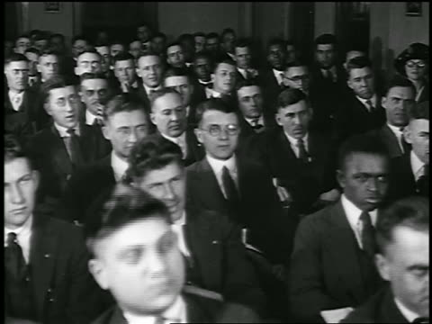 stockvideo's en b-roll-footage met b/w 1920 men in suits sitting at lecture / detroit, michigan / newsreel - caucasian ethnicity