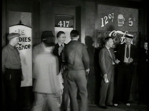 men in suits standing outside bar pub talking other men entering pub w/ advertising on wall bg '12oz beer 5 cents' - prosperity stock videos & royalty-free footage
