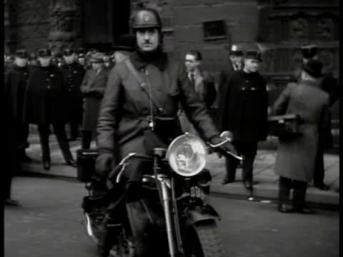 men in suits talking w/ gendarmes on motorcycle, men in suits talking in group. int police station desk w/ officer handing another paperwork. - ゲシュタポ点の映像素材/bロール