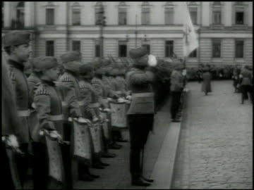 men in suits walking in parade. soldiers standing at edge of street. president of the republic of finland kyosti kallio walking w/ soldiers.... - parade stock videos & royalty-free footage