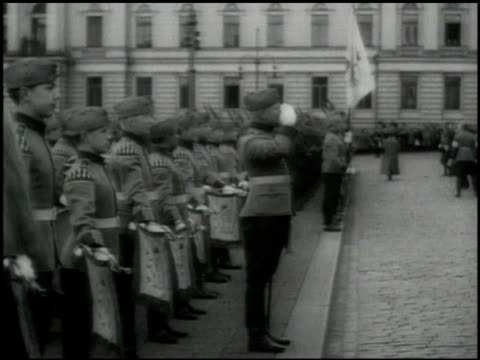 men in suits walking in parade. soldiers standing at edge of street. president of the republic of finland kyosti kallio walking w/ soldiers.... - independence stock videos & royalty-free footage