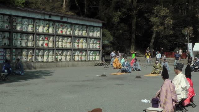 men in traditional costume preparing for shinto ritual - samurai stock videos & royalty-free footage