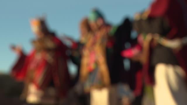 Men in traditional ritual clothing performing traditional rituals, in Kalasasaya, Tiwanaku [Tiahuanaco/Tiahuanacu], Bolivia