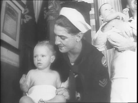 vídeos de stock, filmes e b-roll de men in uniform each with a baby in diapers lined up at a table / montage of men in uniform changing and folding diapers as a woman in white oversees... - campo de treinamento militar