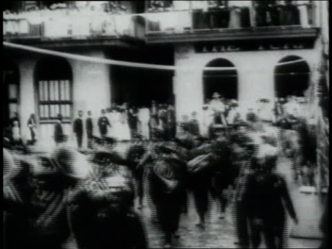 ws men in uniform walking and on horseback moving through a village / republic of panama - 1906 stock-videos und b-roll-filmmaterial