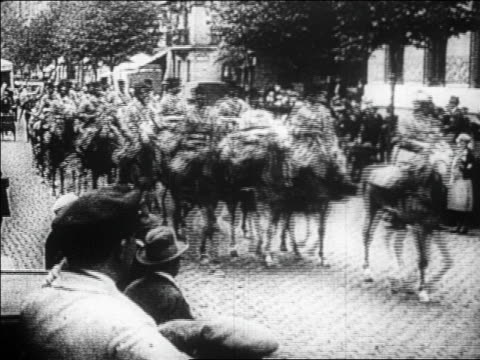 vídeos de stock, filmes e b-roll de b/w 1923 men in uniforms riding horses in parade on city street / french occupation of ruhr district - 1923