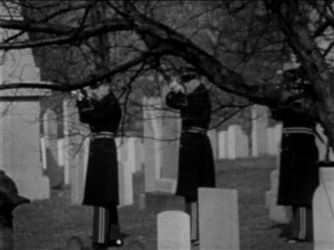 b/w 1967 men in uniforms shooting rifles in salute at burial of apollo 1 crew / newsreel - 1967 stock-videos und b-roll-filmmaterial