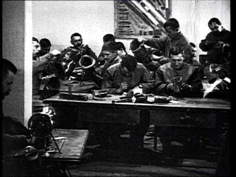 1915 MONTAGE B/W Men in workshop making prosthetic limbs for disabled war victims/ Russia