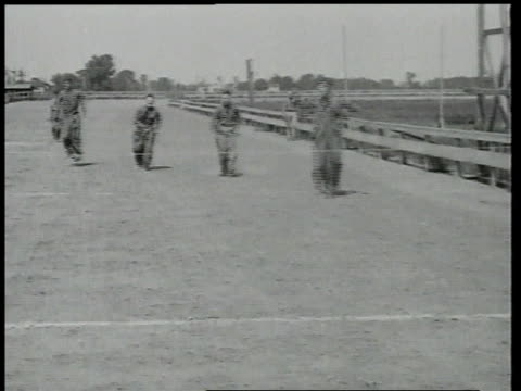 1918 ws men jumping in a sack race, one falling spectacularly / brooklyn, new york, united states - coney island brooklyn stock videos & royalty-free footage