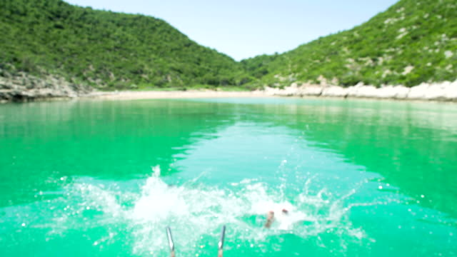 slo mo men jumping into water - adriatic sea stock videos & royalty-free footage