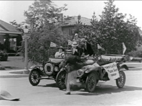 b/w 1927 men jumping out of convertibles after collision on street / feature - 1927 stock videos & royalty-free footage