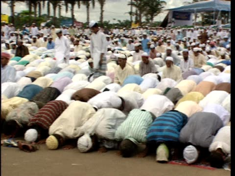 men kneel and bow in prayer - bangladesh stock videos & royalty-free footage