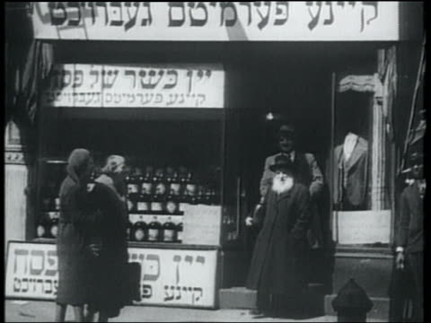 b/w 1932 men leaving kosher wine store as women pass on sidewalk / lower east side, nyc - judaism stock videos & royalty-free footage