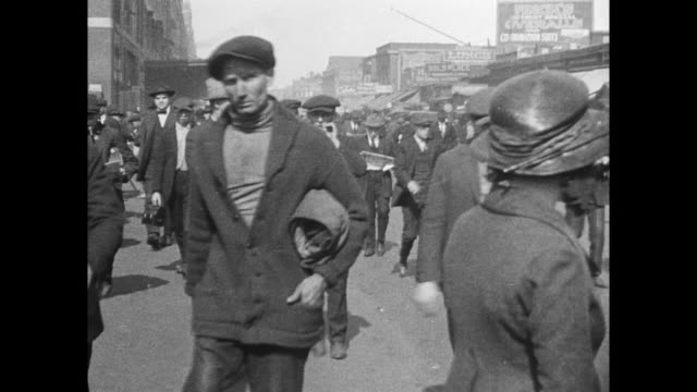 men leaving work from factory, boarding trolleys - 1910 stock videos & royalty-free footage