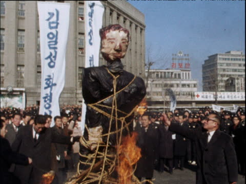 Men light an effigy of North Korean leader Kim IlSung on fire during an anticommunist demonstration in Seoul Feb 68