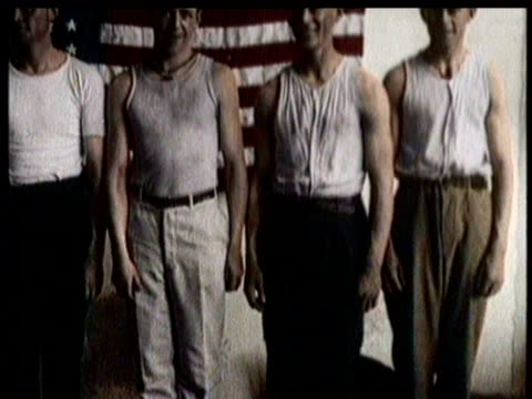 stockvideo's en b-roll-footage met men line up outside draft board offices waiting to sign up for world war i / men sign up for military duty / new soldiers wear uniforms and hold guns... - rekruut