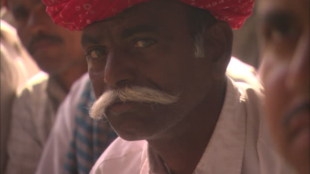 men listen attentively to public address rajasthan available in hd. - moustache stock videos & royalty-free footage