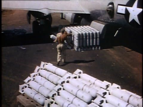 men load bombs onto plane / guam - guam stock videos & royalty-free footage
