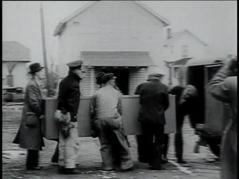 men loading a casket into a hearse / manitowish waters, wisconsin, united states - 1934 stock videos & royalty-free footage