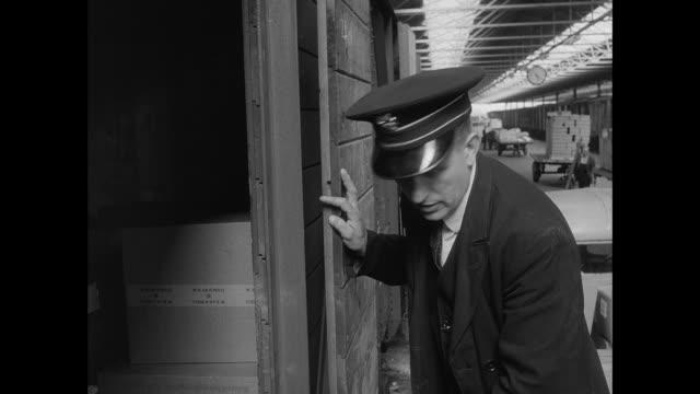 men loading cargo - british rail stock videos & royalty-free footage