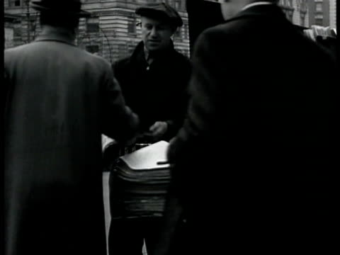 men loading stacks of newspapers into back of truck 'new york times.' adults purchasing the paper from newsstand man giving back change. man w/... - selling stock videos & royalty-free footage