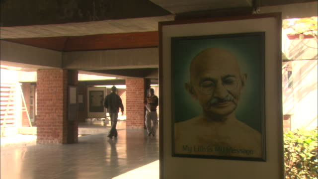 men look at notices and pictures in mahatma gandhi museum available in hd. - crime and murder stock videos & royalty-free footage