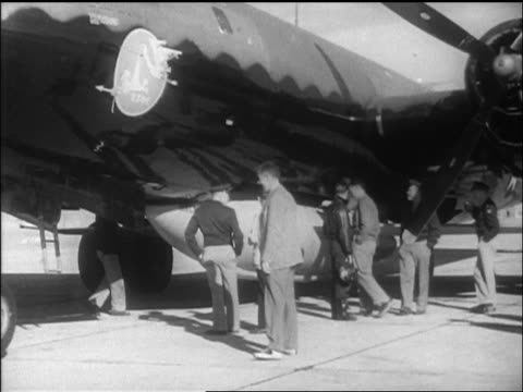men looking at b-29 with bell x-1 airplane attached to it / california / newsreel - 1947 stock videos & royalty-free footage