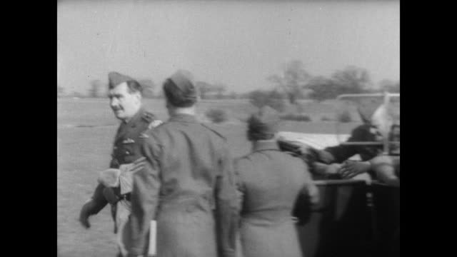Men looking at planes at an aircraft museum in England / CU Bristol Fighter planes / World War I era car arrives with reenactors wearing 1917...