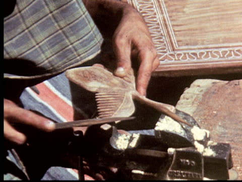 stockvideo's en b-roll-footage met 1960 montage men making wooden objects. pounding ivory into inlaid table with hammer. beautiful inlaid wooden box / pakistan - kleine groep dingen