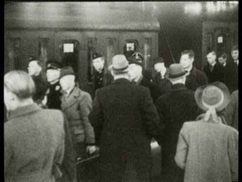 stockvideo's en b-roll-footage met men march to the train station where they will leave for the battlefront family of the men and mussert see them off - slagfront