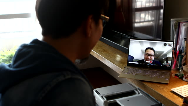 men meeting online - using laptop stock videos & royalty-free footage