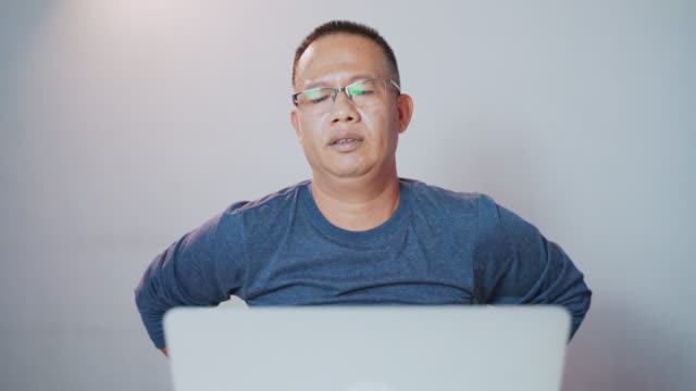 men of asian descent aged 40-50 years, sitting and working at home. exercise and relax after stress and feel the pain in the body. from using the computer for a long time - chiropractic adjustment stock videos & royalty-free footage