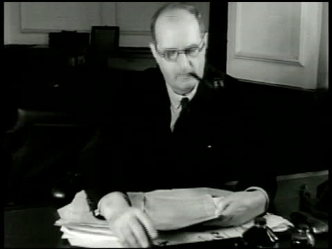 men of technical advisory committee on post-war nutrition in meeting, leader economist sir frederick leith-ross smoking pipe at table, us civilian &... - rebuilding stock videos & royalty-free footage
