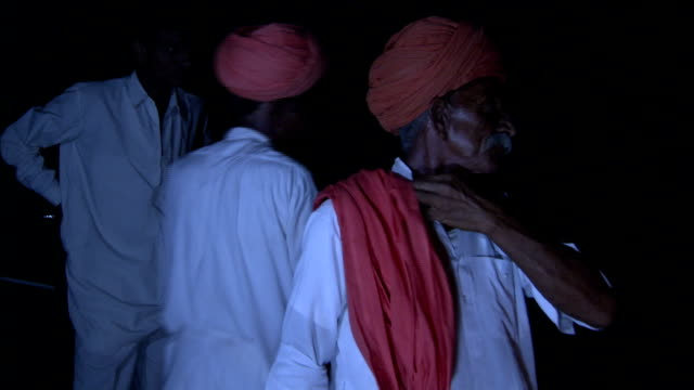 men of the bishnois community perform a washing ritual around a basin. available in hd. - turban stock videos & royalty-free footage