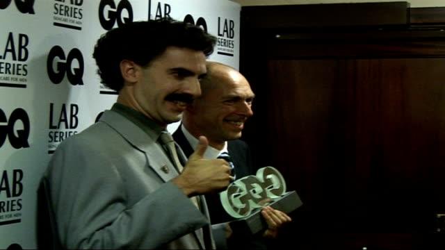 interviews borat posing for photocall with gq editor dylan jones and away - borat sagdiyev stock-videos und b-roll-filmmaterial