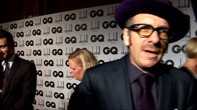 men of the year awards 2009; elvis costello interview sot - on his hat / doesn't think much about fashion, usually looks as if he's been dragged... - elvis costello stock-videos und b-roll-filmmaterial