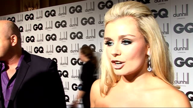 men of the year awards 2009; ross kemp speaking to journalist katherine jenkins interview sot - on her dress - it's from victoria beckham's range,... - kilometre stock videos & royalty-free footage