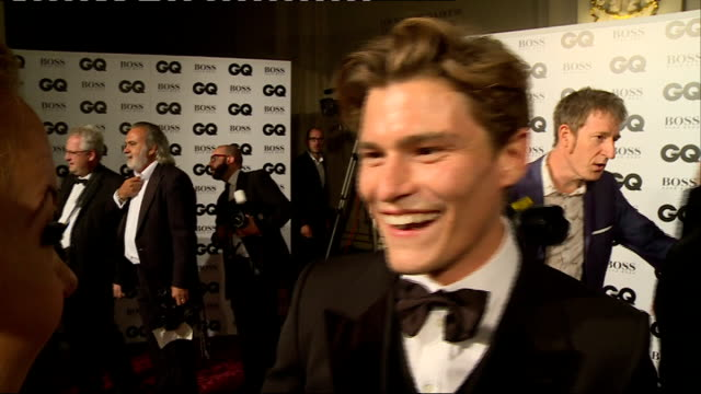 men of the year awards 2014: arrivals and interviews; england: london: int danny wallace posing for press with gq awards backdrop / jools holland... - jools holland stock-videos und b-roll-filmmaterial